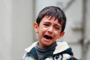 Crying Child - Grief Lingers as Special Needs Children Struggle to Comprehend Eternity